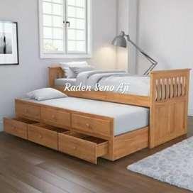 Tempat tidur model bed slorok ful kayu jati.