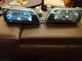 Indus Corolla smoked headlights in excellent condition. For 1992-2001.
