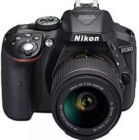 Nikon D5300 camera with 18-55 and 55-300 lens, with extra accessories
