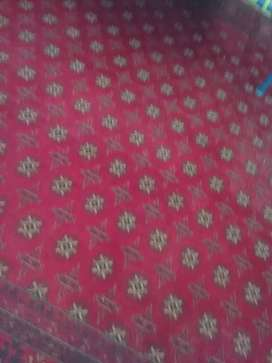 Irani carpet in maroon color perfect for lounge area
