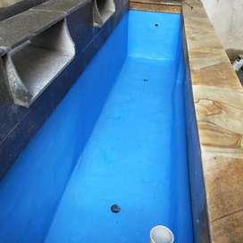Pemasangan kolam setandar ikan koi