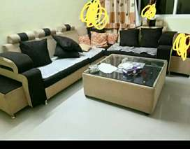 L shape sofa with center table