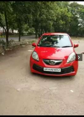 I want to exchang or sale  my  car honda brio 2012  very good cndison