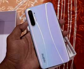 REALME XT WITH A QUAD CAMERA WITH 64MP CAMERA AND A FASTEST FINGERPRIN