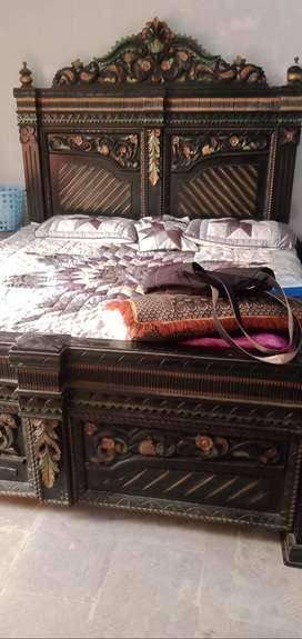 King size bed along with side tables. One piece of dressing table.