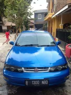Sedan Timor S515i tahun 1999