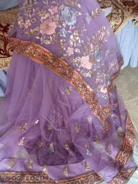 Khubsoorat net saree ,,,with ready blouse and paticoat