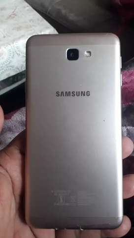J 7 prime  in good  condition  and lady  used  with  charger  paking i