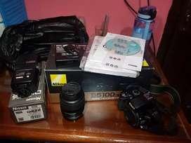 Kamera Nikon D5100 + fles Nisin