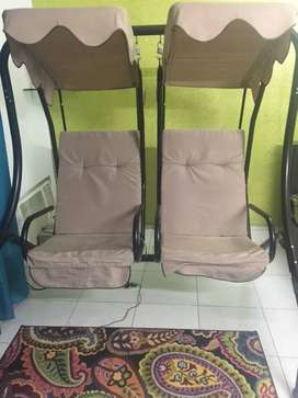 Comfortable 2-Seater Swing with Beige Cushioned seats and Head Cover