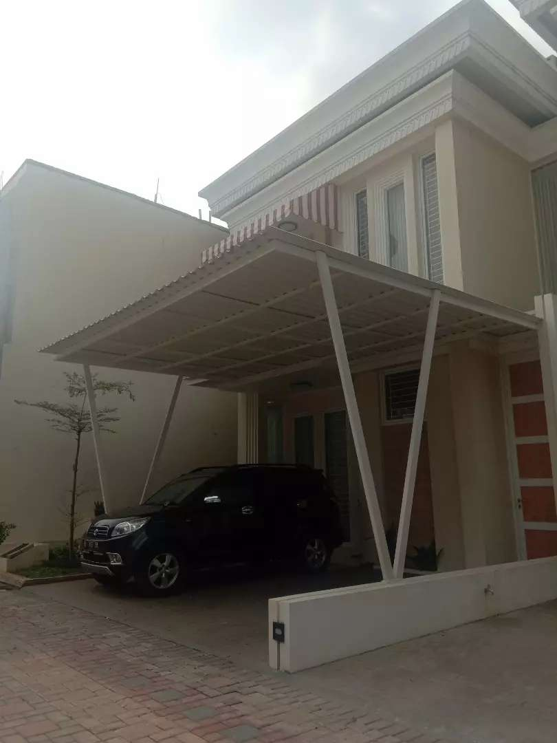 Rumah cluster mewah lokasi  pinggir jalan raya utama 0