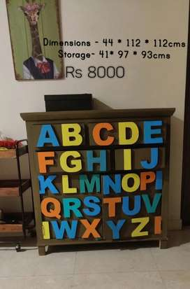 Wooden alphabet cabinet with drawers, toy storage