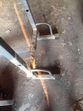 Multipurpose bench having three adjustment,rod,plates,dumbells