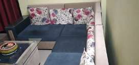 Sofa with center table and sofa and center table is only 6 month old