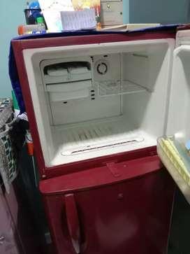 Double door fridge in running condition .