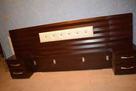 Bed with high back side tables