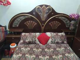 Double bed with complete room setup