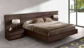 A modern Designer Bed with side table dressing