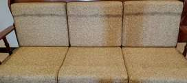Wooden sofa in new condition.