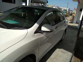 Honda City 2015 Petrol Well Maintained good condition coloured white .