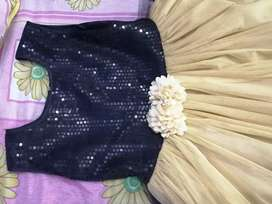 Golden and black frock length 38