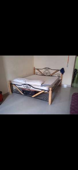 Wooden cot along with mattress