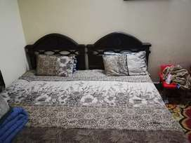 Two single beds of shesham wood for sale with mattress