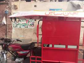 A riksha (Qingqi) in good condition is for sale