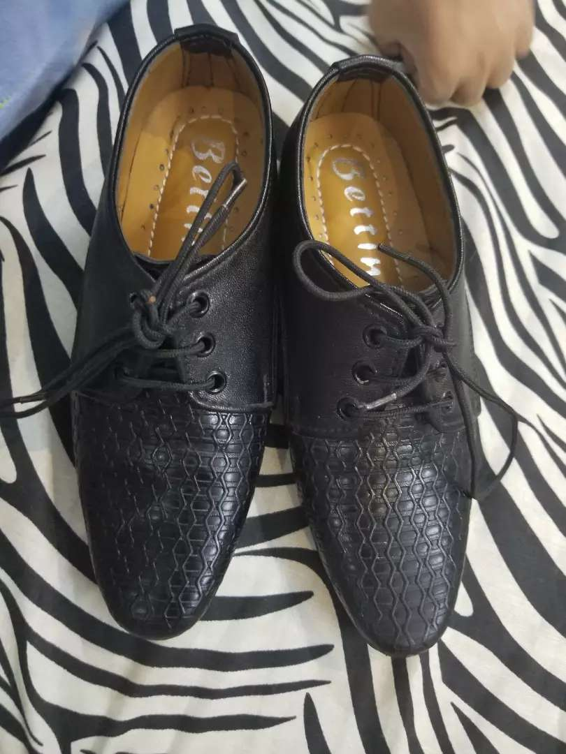 Kids black pointed shoes 0