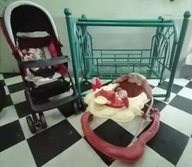 A Baby Swing Cot and A Baby Pram