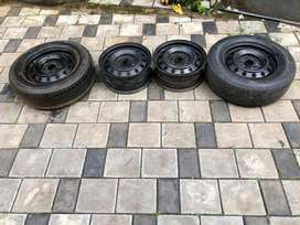 """15"""" innova 4 disk and 2 tyres."""