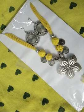 Yellow Metal Necklaces with earrings