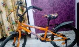 Vibrant orange coloured bicycle