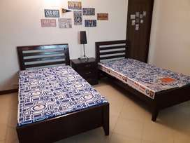 2 Single beds ( solid wood) with mattress and side table