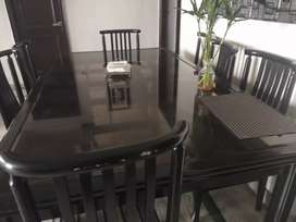 Dining table with 8 chairs with glass top