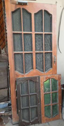 Wooden triple door set with window