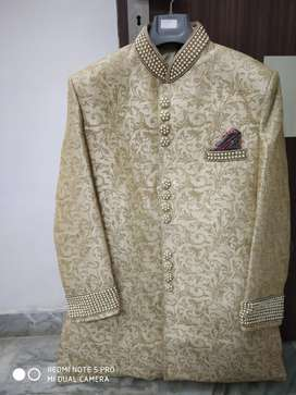 Sherwani complete Set for Men (off while colour with golden touch).