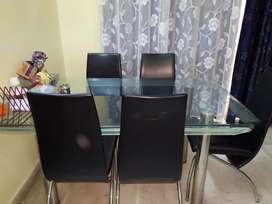 Tempered glass dining table with six chairs