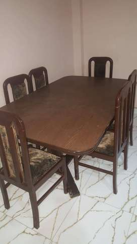 Wooden Dining Table for urgent sale.