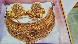 Golden neck set with earings ..low price..