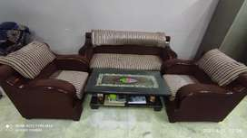 Sofa set with table and covers