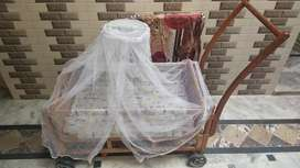 Wooden swing with mosquito net and mattress