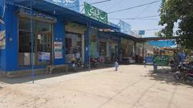 Building with 12 shops on the front adjacent to THQ Hospital in Piplan