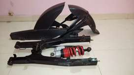 Bajaj Discover 125 st Swing arm with shock absorber , mud flaps