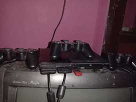 Very nice ps2 with three remotes play in all TV