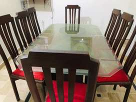 Beautiful glass work Dining table with set of 8 (wooden chairs)