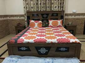 King size bed with 2 bed side tables & a dresser