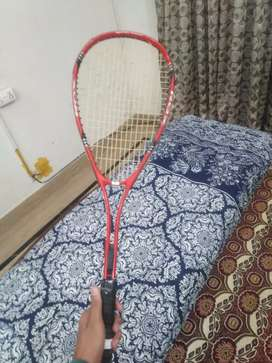 Squash racket for urgent sale 1 year used in good condition