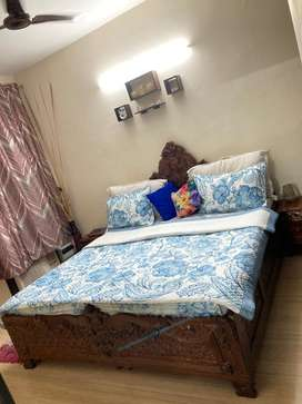 Pure sheesham carved wood double bed, with side tables and matteress