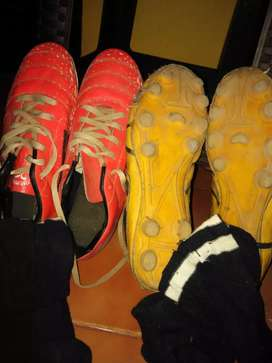 Sega 2 sets of football boots with a pair of 1 blacksockins